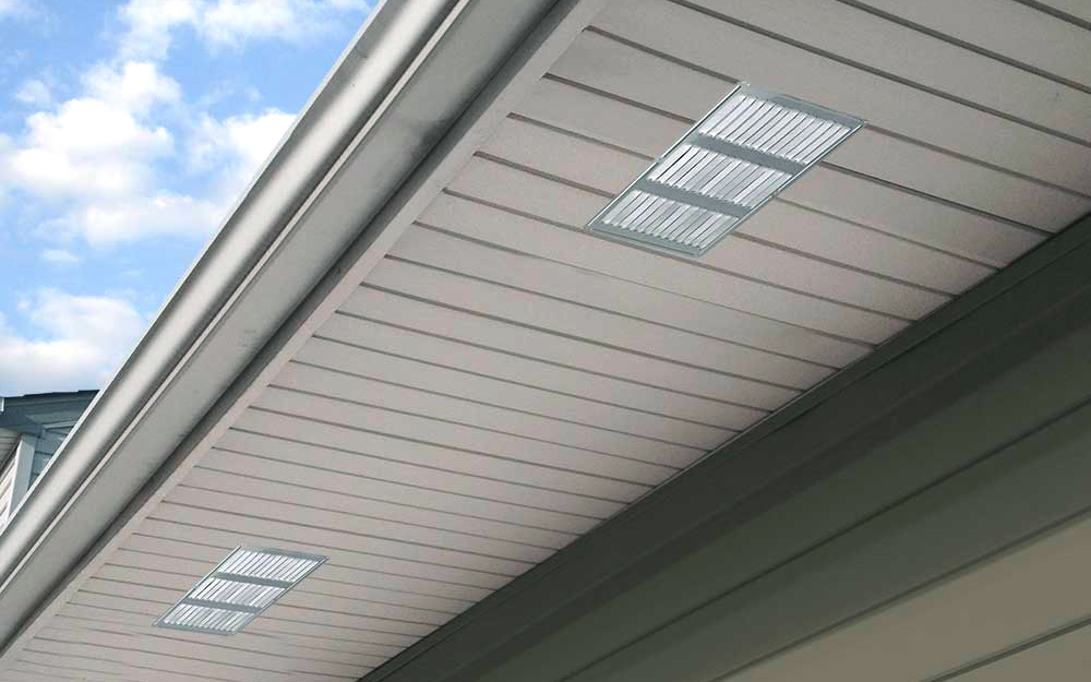 A soffit vent running along the side of a home.