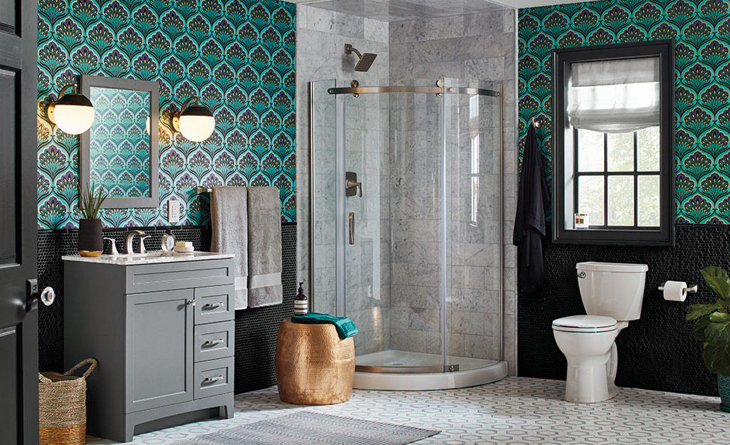 A bathroom with dark green patterned wallpaper.