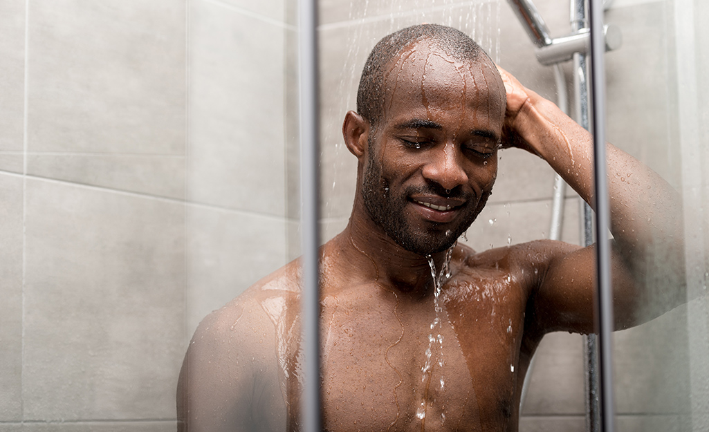 A person in a shower.