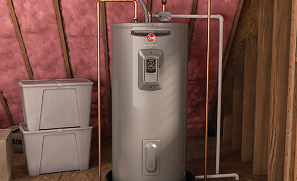 A tank water heater installed in an attic.