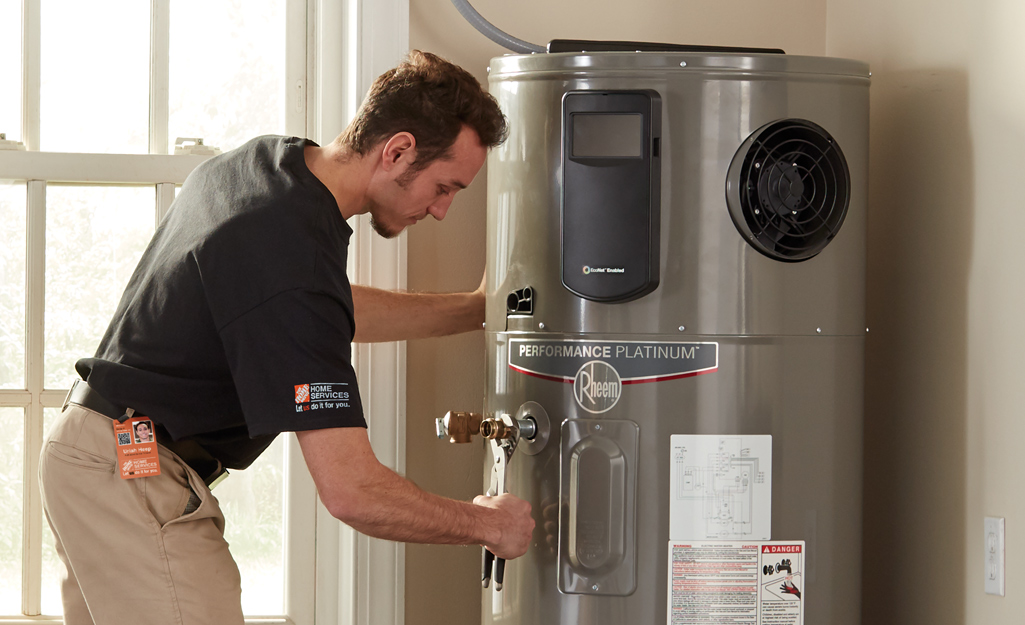 A person adjusts a water heater.