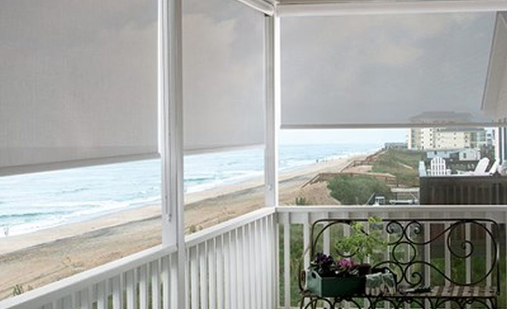 Window coverings installed over a balcony.