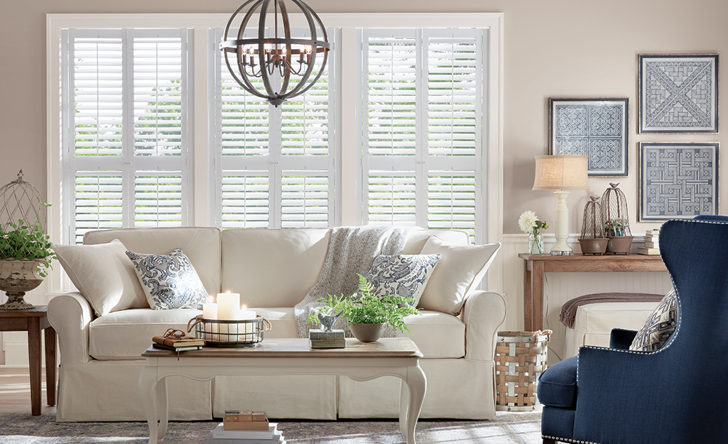 Three rows of white shutters installed on a window.
