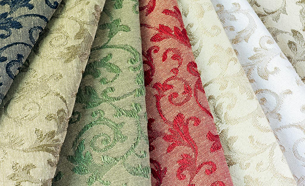 Drapery fabric rolled into rows.