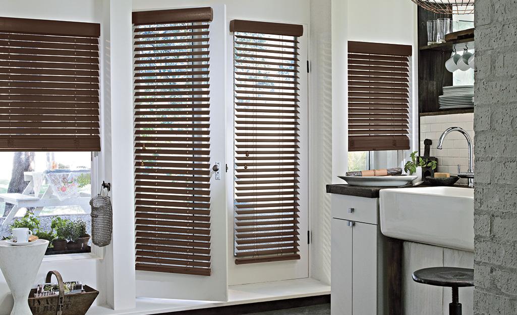 Dark wood blinds installed in a kitchen.