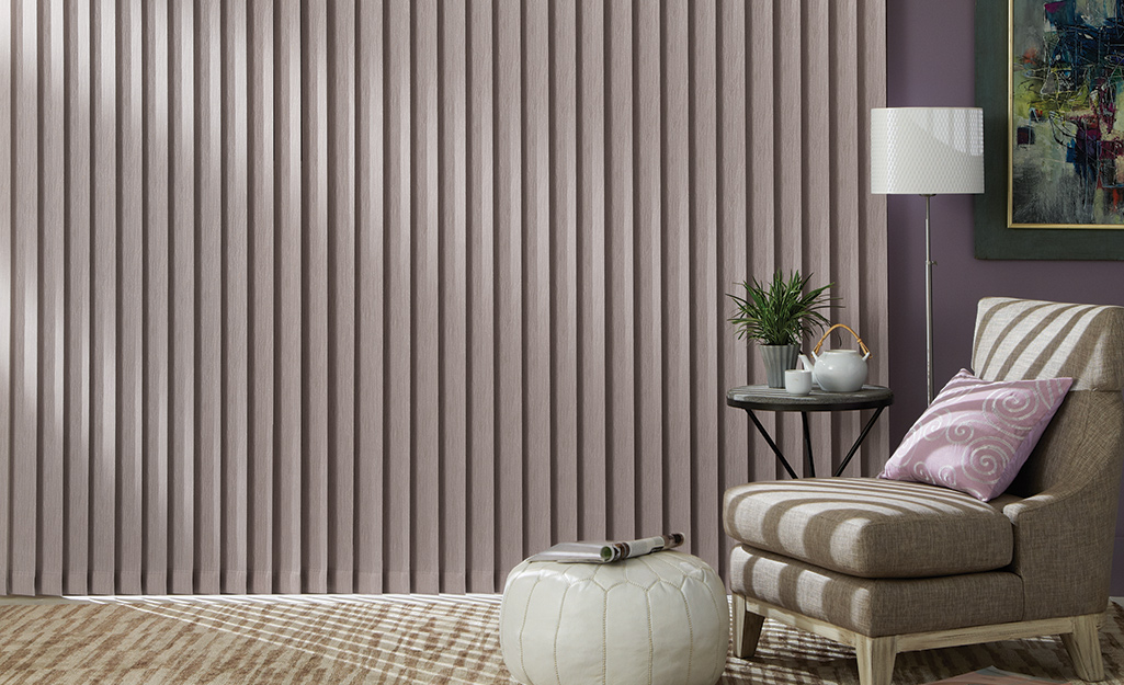 Vertical blinds closed in a sitting room.