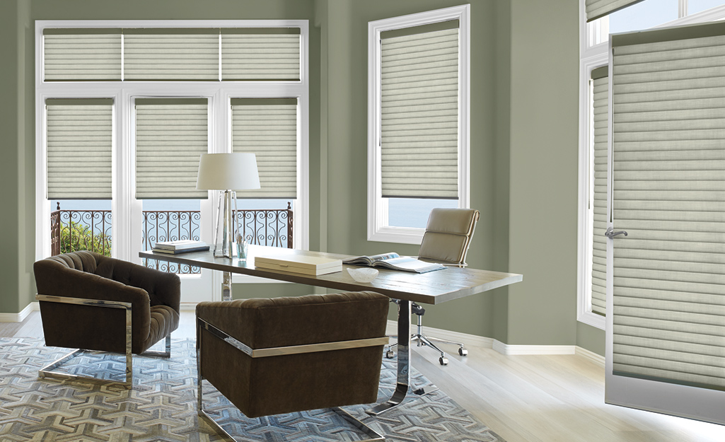 Pleated shades installed on the doors and windows of a home office.