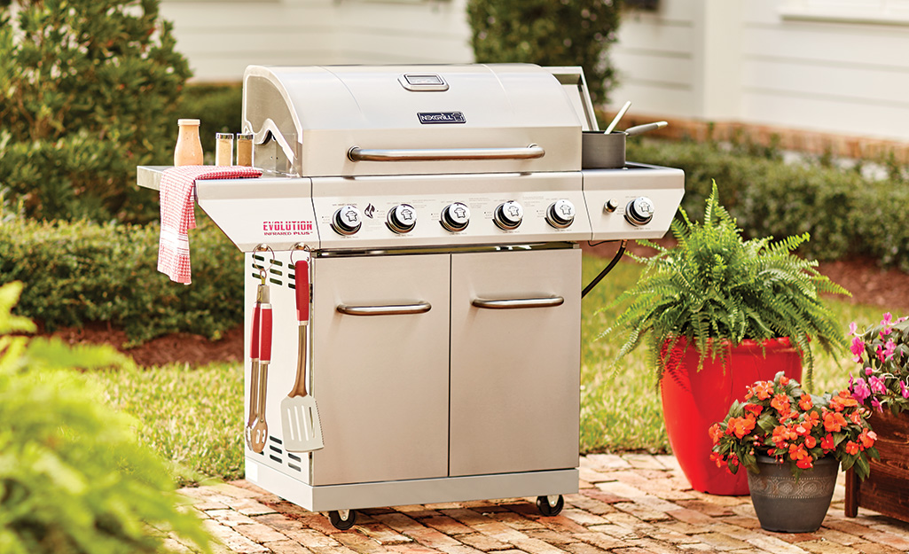 A gas grill on a patio.