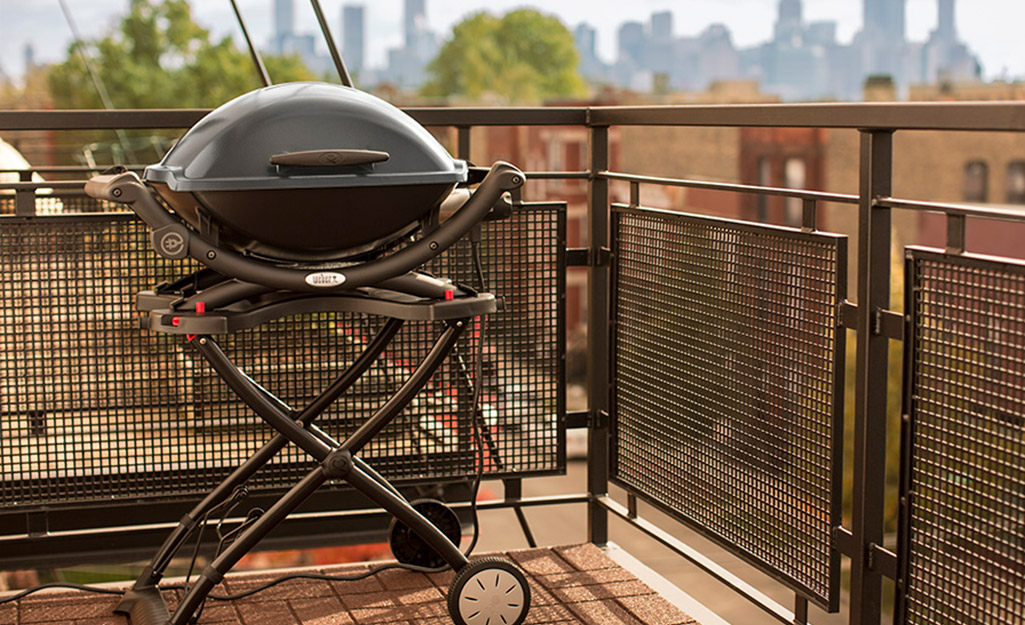An electric grill on a patio.