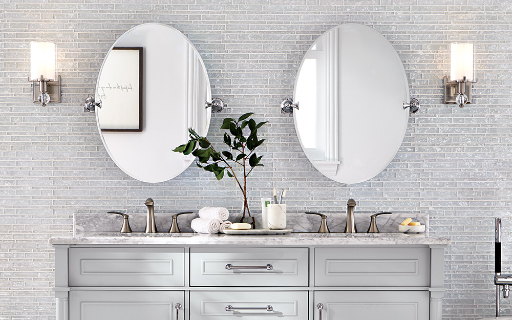 Cool White Vanity Lights With Bright Metal Finishes Installed Over A In Glam