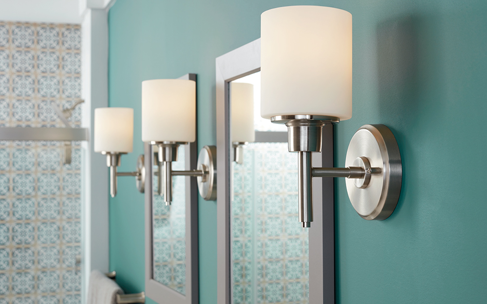 Clic Style Vanity Lighting Complements Two Single Vanities In Medium Brown Wood With Matching Mirrors