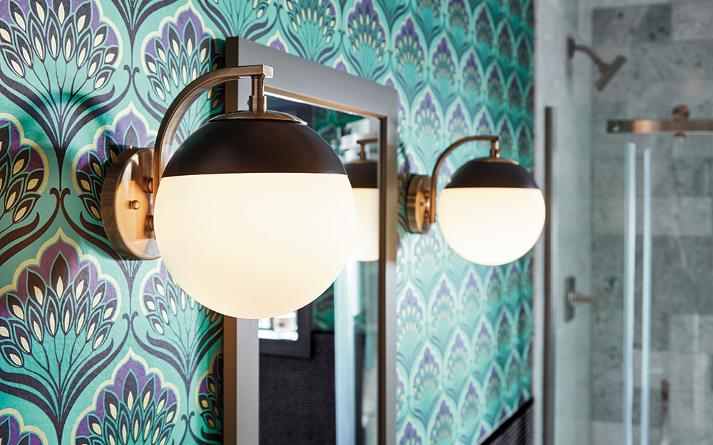 Two vanity light in a transitional style in a mixed decor bathroom.