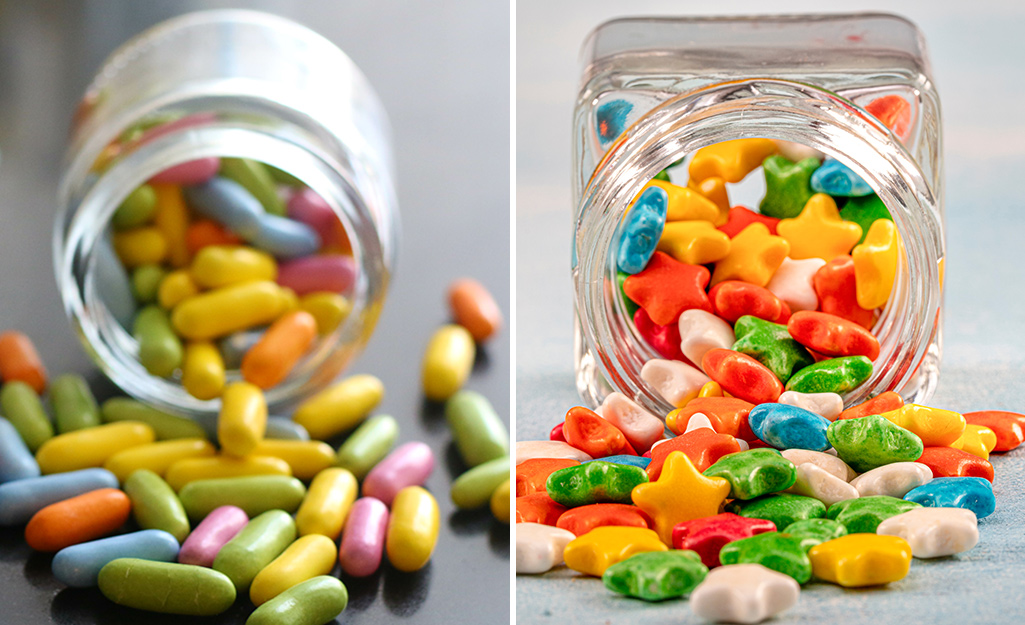 Colorful candy spilling out of containers.