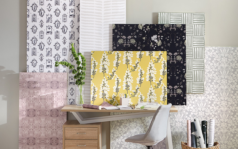 A sampling of different styles and colors of wallpaper that can be used as wall art.