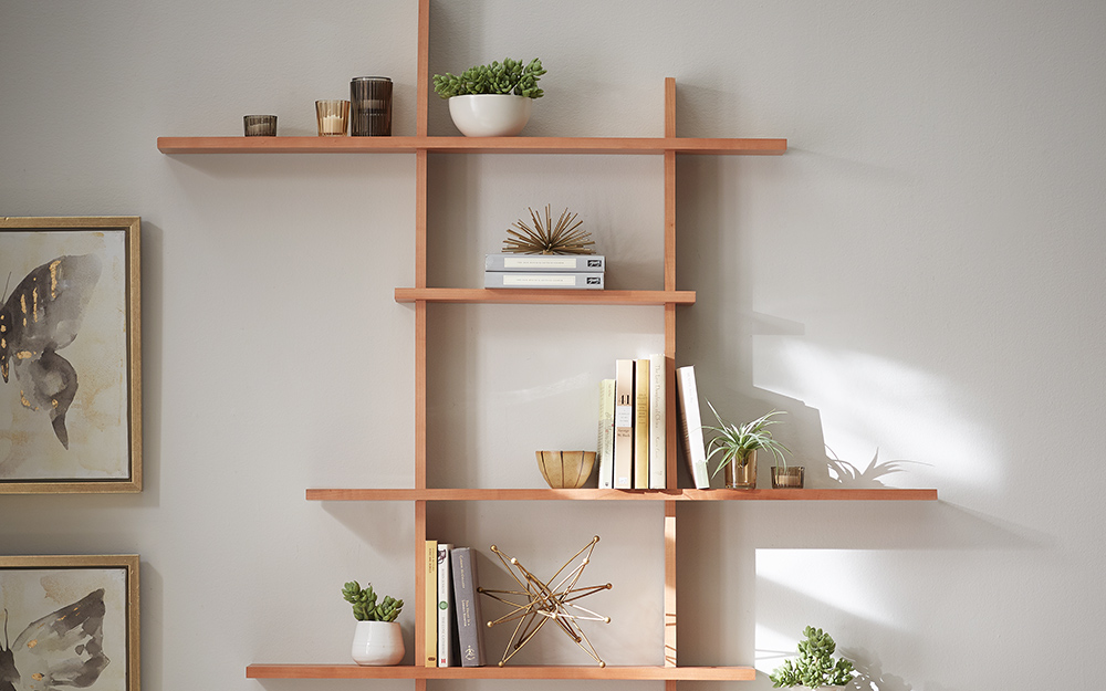 Wall shelves with books, plants and other items used as wall art.