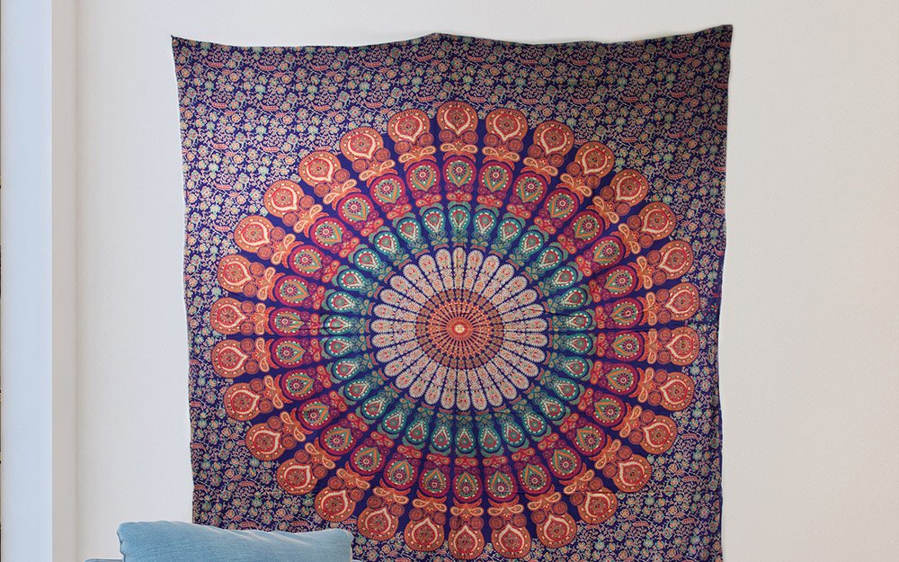 A large tapestry hung as wall art.
