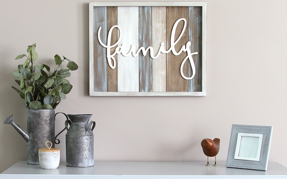 "A framed sign reading ""family"" hung as wall art."