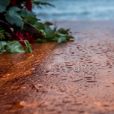 Rain on a wood deck.