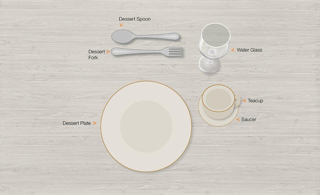 Formal table setting for dessert.