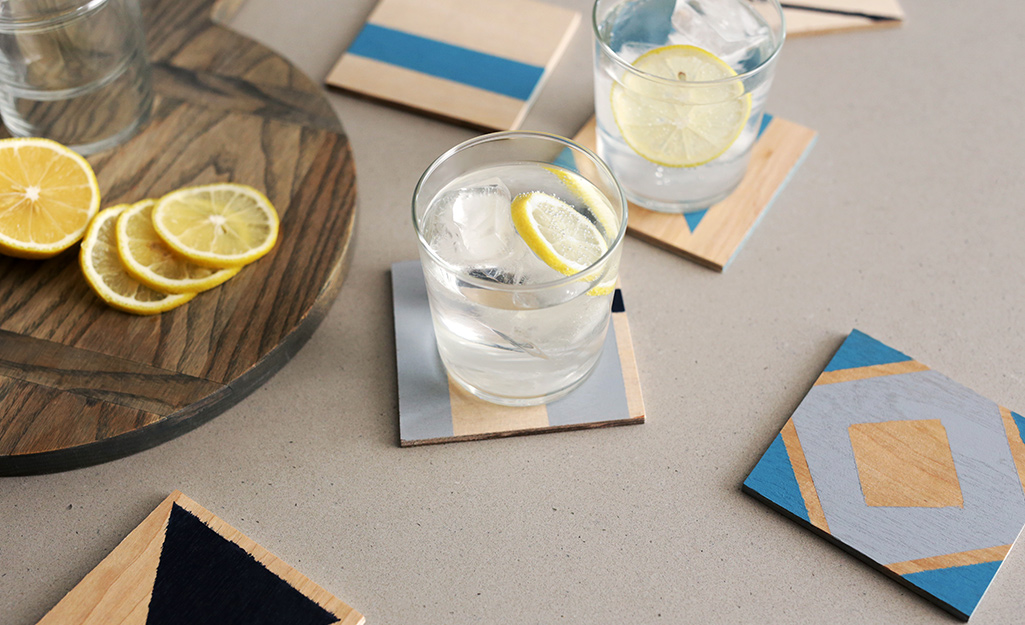 Modern coasters holding drinks on a table