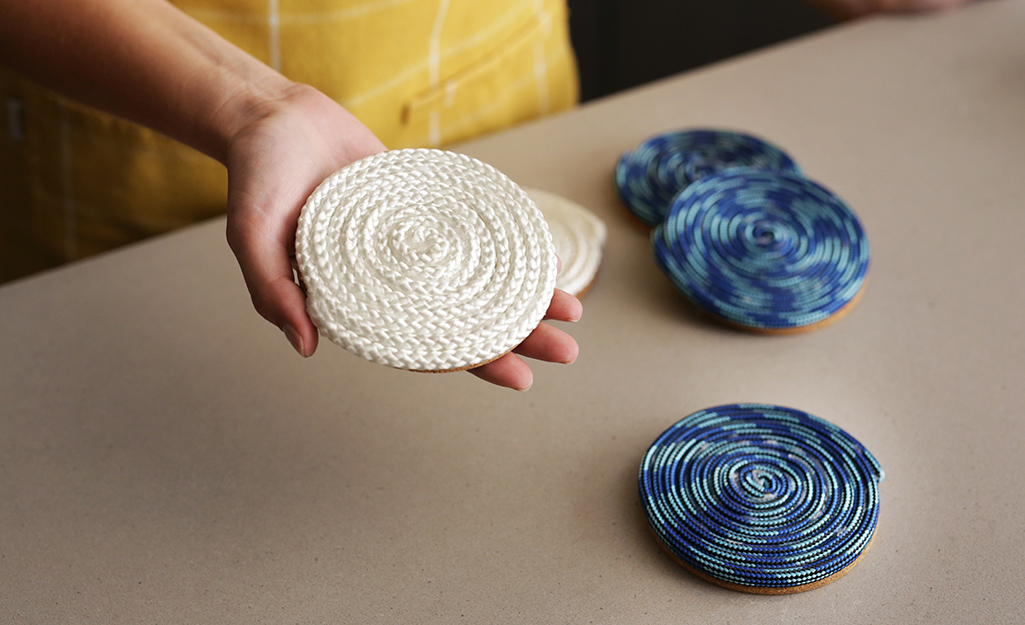 White and blue coasters made out of coiled rope