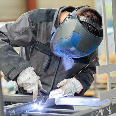 A person welding metal