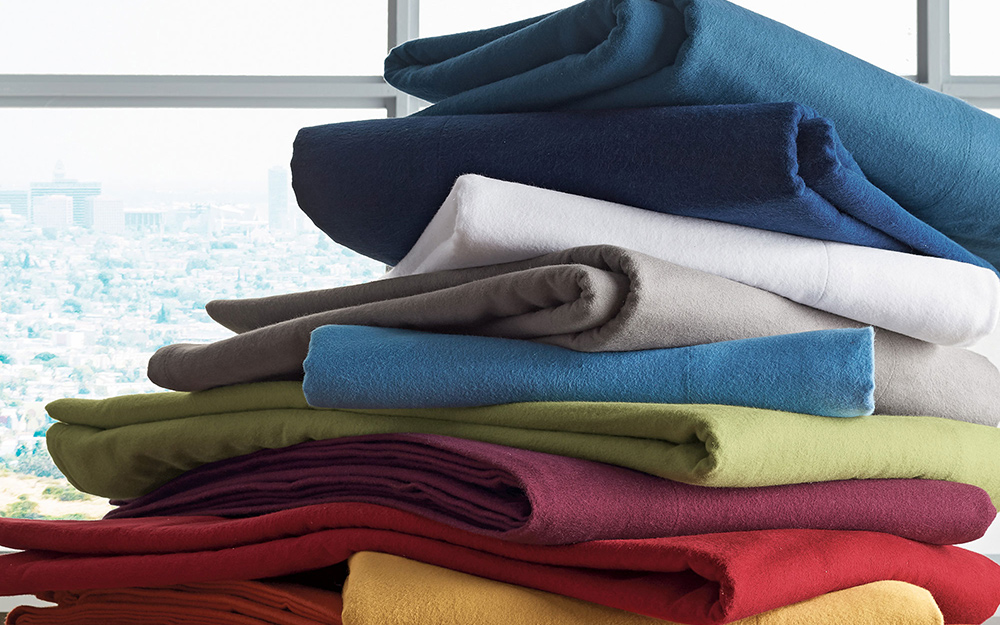 A stack of colorful duvet covers.