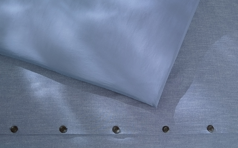 Blue duvet cover with buttons.