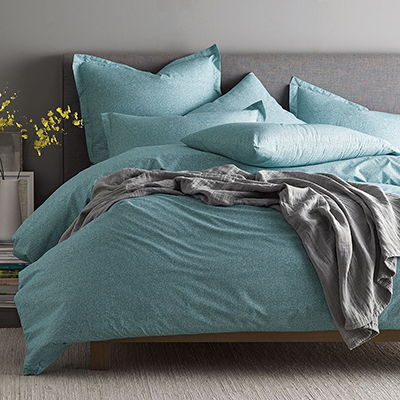 Blue duvet laying on queen bed