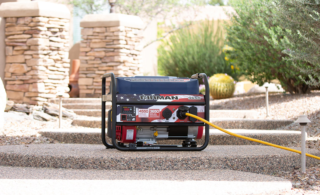 A generator sits on a set of outdoor stairs.