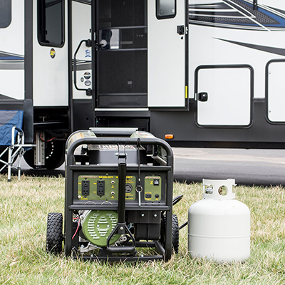 A generator sits in front of an RV.