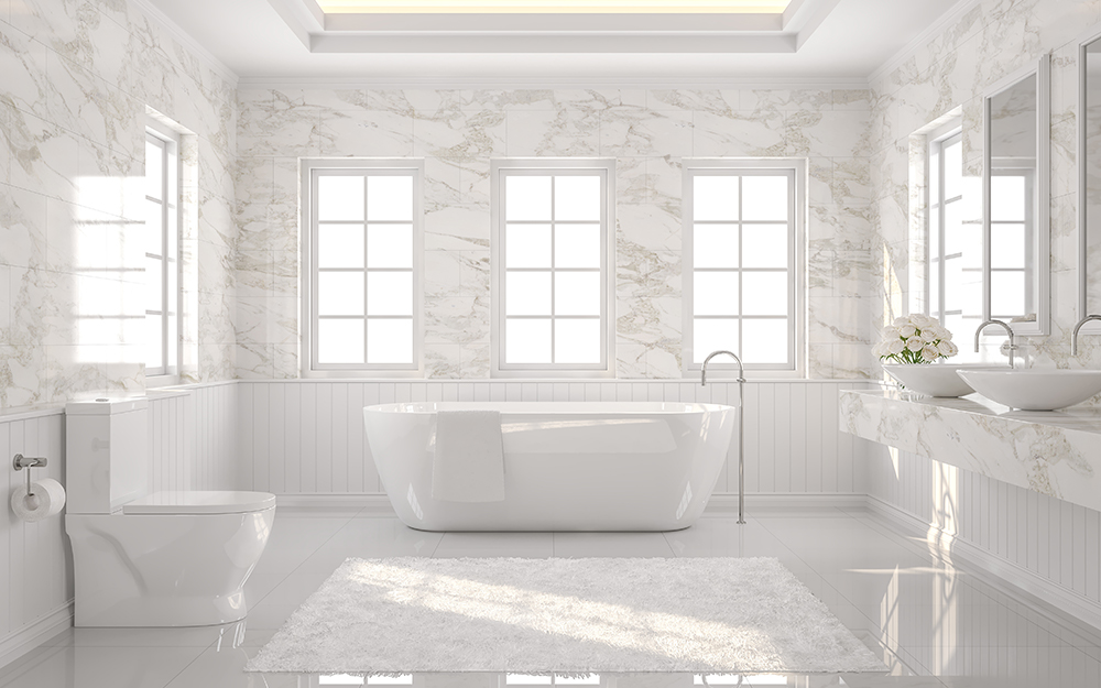 white bathroom with marble patterned wallpaper