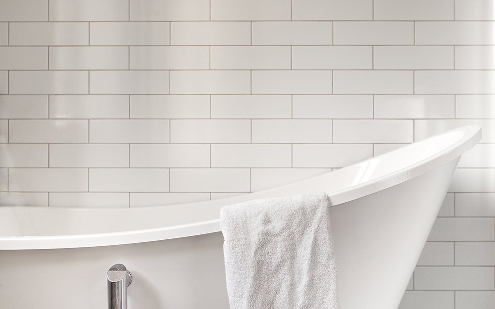 white bathroom with white wall tile