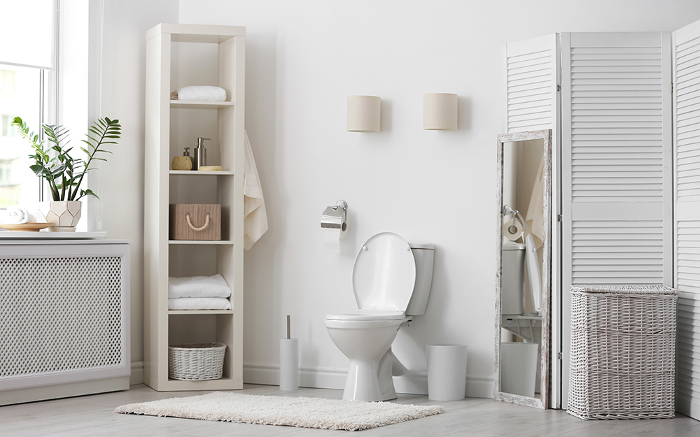white bathroom with freestanding shelf and mounted flush lighting