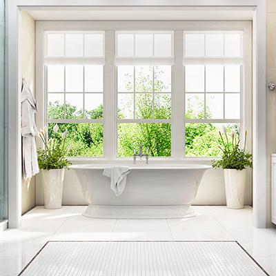 bright white bathroom with open windows