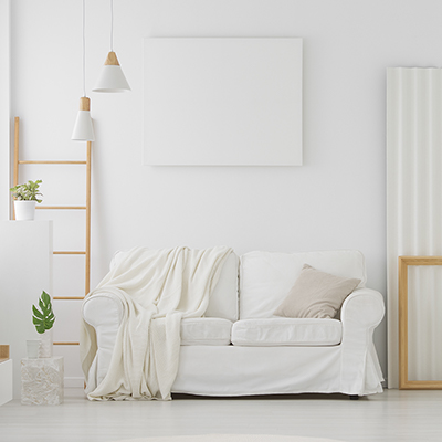 A living room decorated with various shade of white.
