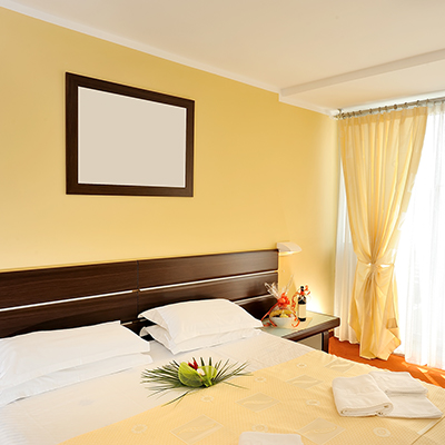 A bedroom with yellow walls.