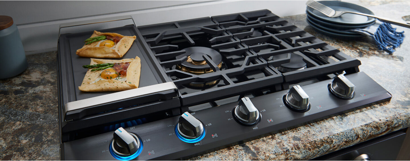 Up to 30% off with cooktop Special Buys.** Prices shown include discounts. Valid 9/27–10/17/2018.