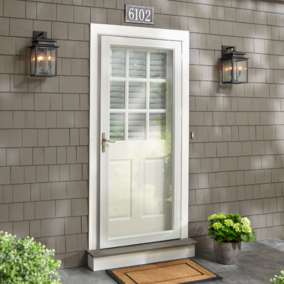 Glass doors take the kitchen outdoors for Exterior glass doors home depot