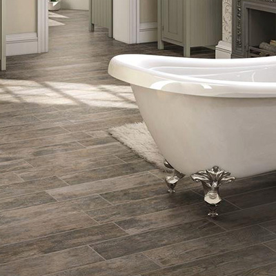 Introduce a natural element to your bath with resilient, water-resistant wood or stone look porcelain tile.