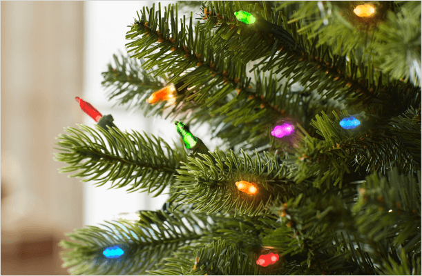 close up of christmas tree with color changing lights - Christmas Tree Branch Decorations