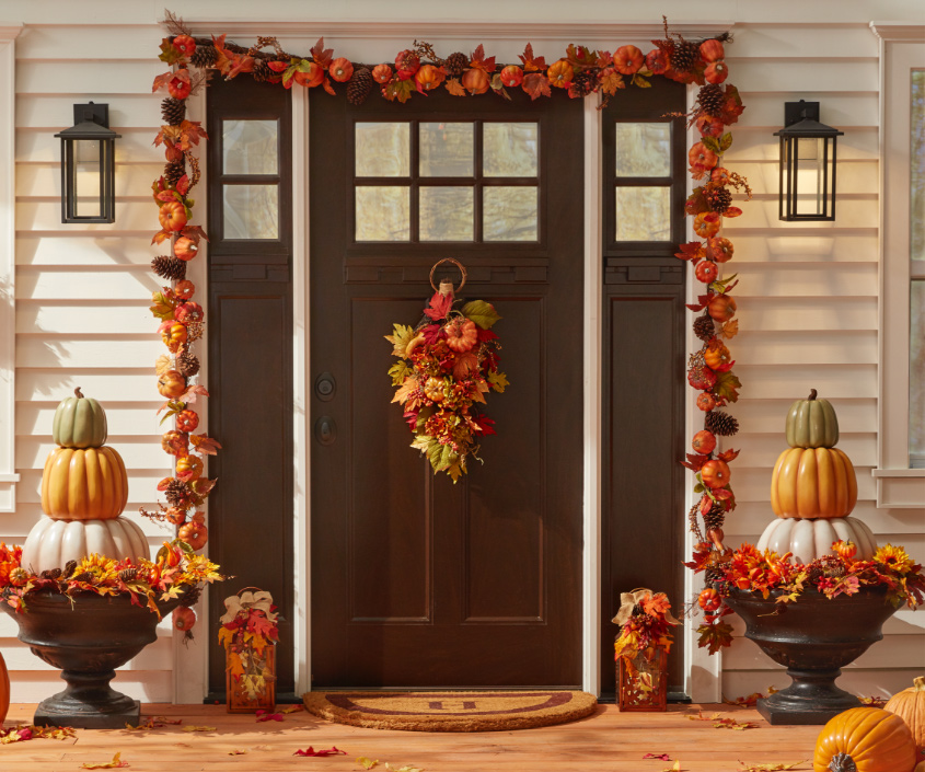 decorated front porch with pumpkins and fall wreathes