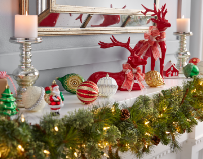 Assorted Christmas decorations on a fireplace mantle