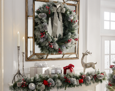 wreaths garland over a white fireplace mantle