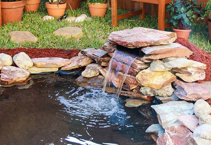 Selecting the right water garden pumps for your pond at for Koi pond kits lowes