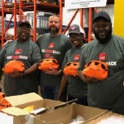 Owens Corning employees holding a volunteer project