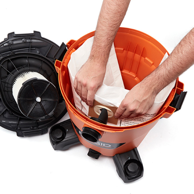 Remove the powerhead from the drum. Align the cardboard collar with the vacuum's inlet.