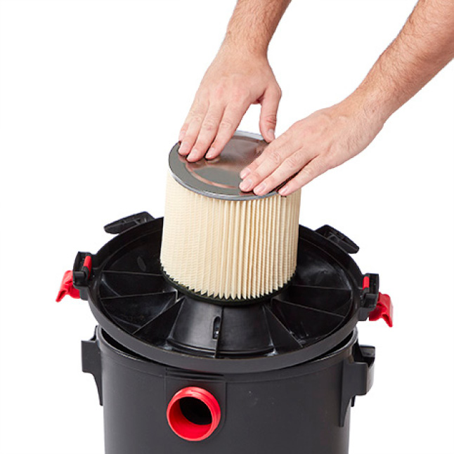 Press down on the filter until it is flush with the base of the filter cage.