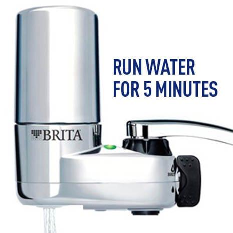 Run faucet to flush filter