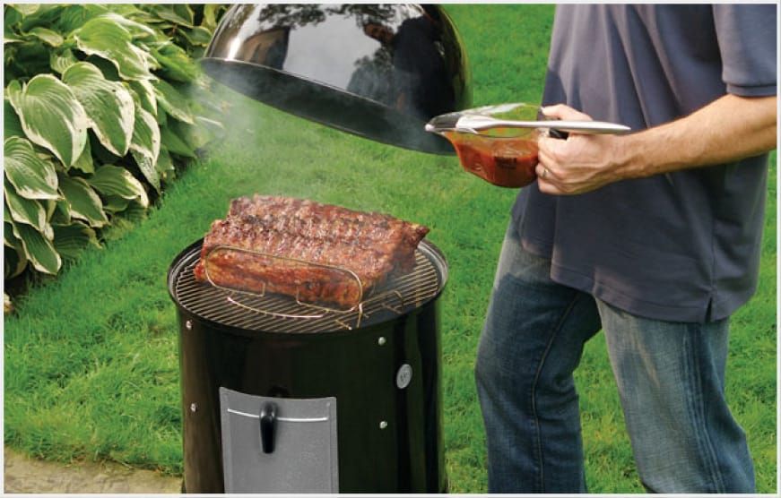 The porcelain-enameled lid, bowl, and center section retain heat for consistent smoking.